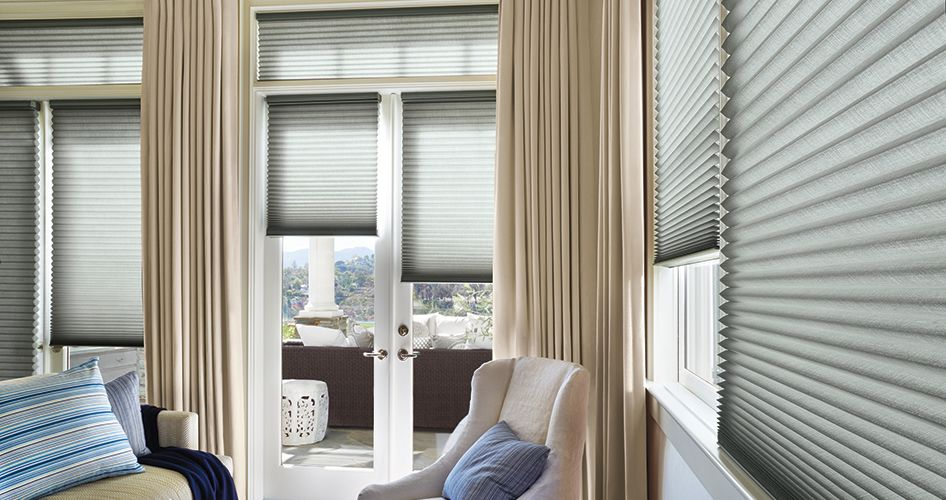 Alustra Duette honeycomb shades with drapes