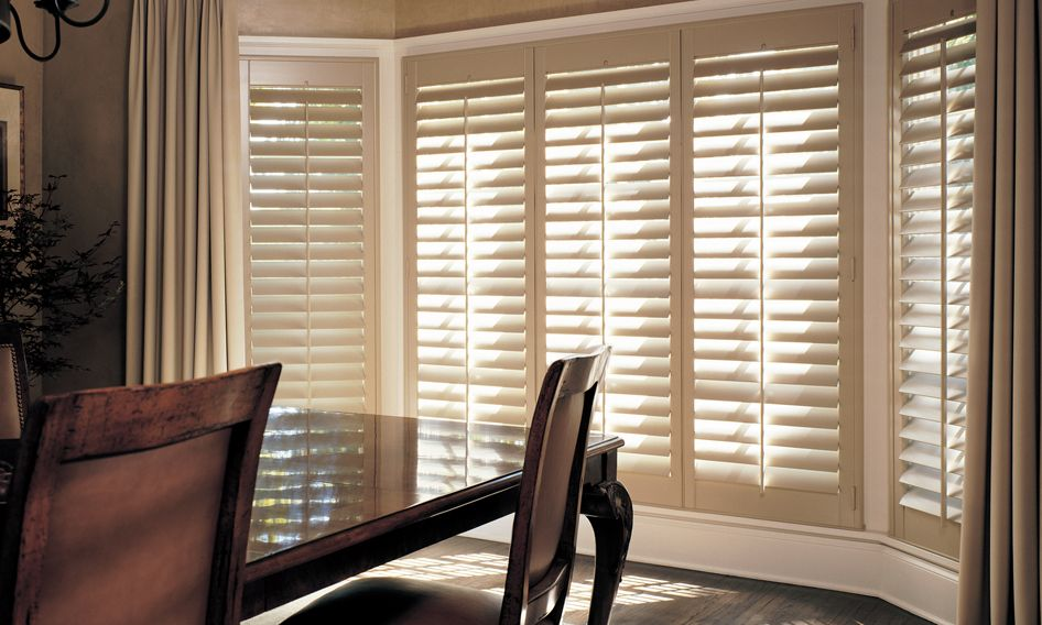 Heritance shutters with bay windows in dining room