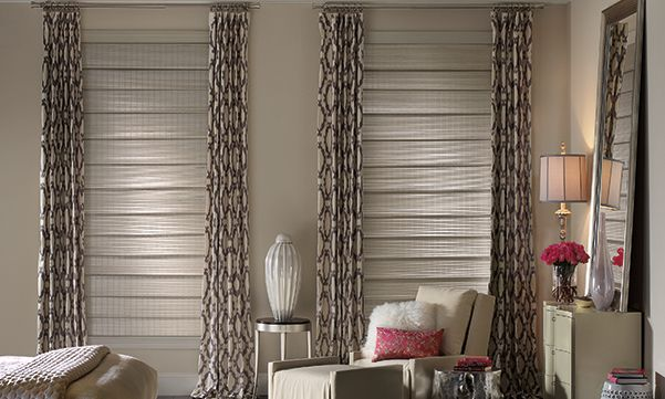 Provenance woven wood shades with drapes in a bedroom