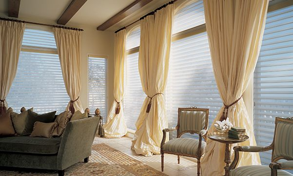 Silhouette window shadings with drapes in a living room
