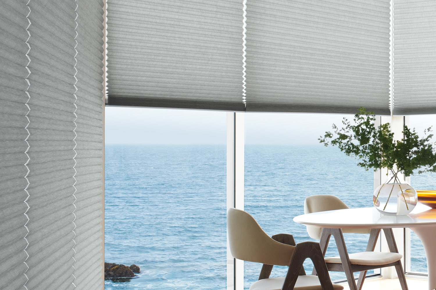 Ocean view out window with Duette Honeycomb Shades.