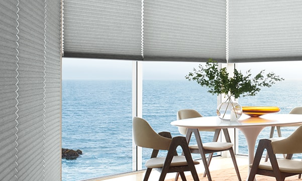Insulated honeycomb shades in dining room