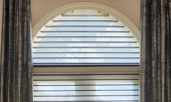 silhouette shades on arched windows