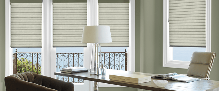 Sonnette Cellular Roller Shades in an office.