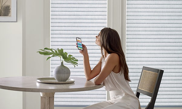 Woman using PowerView app on Sonnette