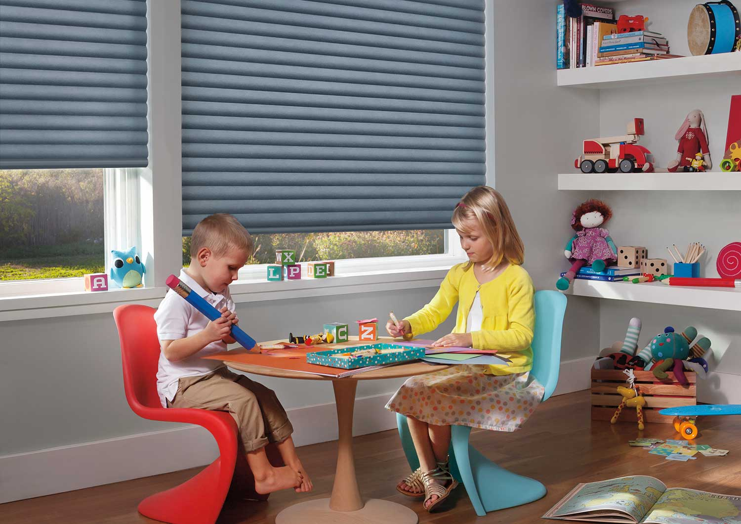 Children safely playing around Sonnette Cellular Roller Shades.