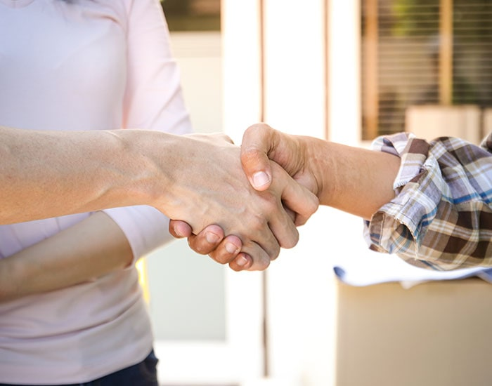 Shaking hands after a successful project