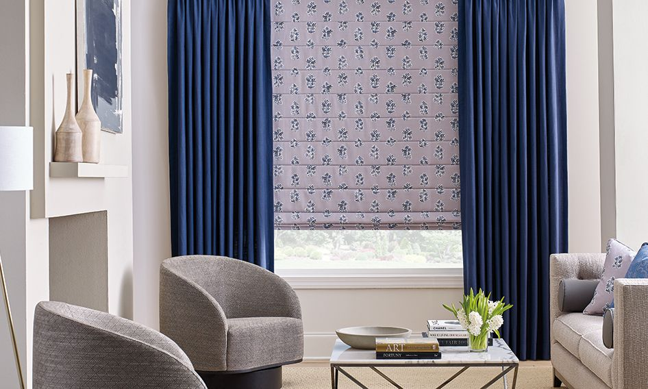 Design Studio roller shades and drapery in living room