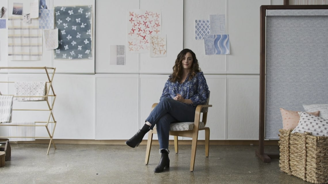 Rebecca Atwood sitting in her studio.